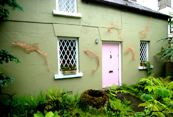 Salmon sculptures on house
